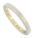 This unique antique platinum wedding band is engraved with a repeating pattern of circles and pairs of diagonal lines