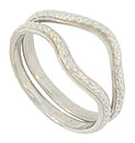 Strings of posies framed in distinctive milgrain decoration covers the surface of these 14K white gold curved wedding bands