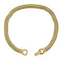 Elegant serpentine links crafted of 14K yellow gold comprise the surface of this vintage bracelet
