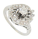 This phenomenal vintage engagement ring features a floral inspired mounting
