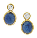 These exceptional antique style earrings are adorned with deep blue cabochon sapphires topped with sparkling round cut diamonds