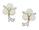 Trios of luminous pearls form flowers on these vintage 14K white gold earrings