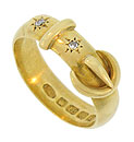 This magnificent antique buckle ring is fashioned of 18K yellow gold and set with a pair of brilliant round cut diamonds