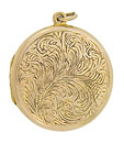 This English Victorian 15 carat yellow gold locket is embellished with and intricate etched engraving of feathery ferns