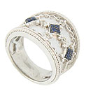 This sparkling sterling silver band is frosted in quartets of deep blue sapphires and sparkling white sapphires