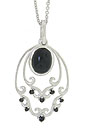 An oval cabochon onyx is bezel set in this sterling silver antique style pendant necklace