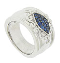 This elegant wide sterling silver band features a marquis shaped figure filled with deep blue fine faceted sapphires
