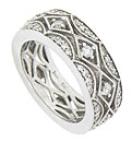 Bold scalloped cutwork frames a string of diamond shaped figures on the face of this antique style wedding ring