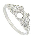 Crafted of platinum, this antique style engagement ring mounting will hold a round cut stone in bold prongs