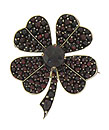 This exceptional estate pin is crafted of 14K yellow gold and fashioned in the shape of a four leaf clover