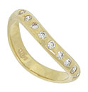 This lovely curved estate wedding band is fashioned of 14K yellow gold and deep set with dazzling round cut diamonds