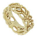 Abstract organic flowers and vines twist across the surface of this 14K yellow gold antique style wedding band