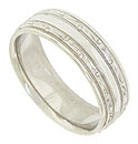 This 14K white gold mens wedding band features a smooth polished central band framed by engraved ribbons of organic figures outlined with strings of impressed milgrain decoration