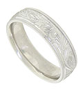 This 14K white gold mens wedding band features a wide engraved band