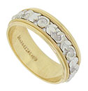 An intricately engraved white gold floral band is pressed into the center of this handsome yellow gold wedding ring