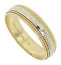 This handsome 14K bi-color mens wedding band features a multi-faceted white gold ribbon pressed into a band crafted of yellow gold