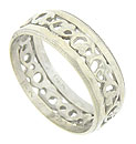 This antique 14K white gold wedding band features a central band of intricate floral cutwork