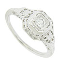 This exquisite 14K white gold antique engagement ring is set with a .15 carat, H color, Si2 clarity round cut diamond