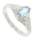 A radiant .60 carat, oval cut aquamarine sparkles from the center of this antique style engagement ring