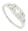 This spectacular 14K white gold antique engagement ring is set with a .13 carat, H color, Si2 clarity round cut diamond