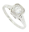 This romantic 14K white gold antique engagement ring is set with a fiery .32 carat, G color, Si1 clarity round cut diamond