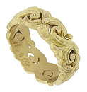 Bold abstract floral cutwork and vines spin across the surface of this antique 18K yellow gold wedding band