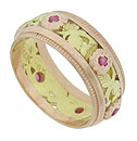 This exceptional vintage floral wedding ring features a romantic center band of red gold roses and green gold leaves