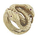 A pair of intricately engraved twisting snakes curl around the surface of this unique 10K yellow gold estate ring