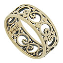 A graceful design of pressed milgrain curls around the center of this antique wedding ring