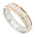 A multi-faceted hewn surface covers the face of this 14K bi-color mens wedding band