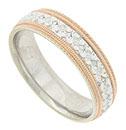 Ropes of twisting red gold and bold milgrain frame a white gold band of deeply engraved florals on this 14K bi-color mens wedding band