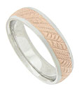 This 14K bi-color mens wedding band features a repeating pattern of 14K white gold diagonal engraved ribbons
