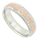 Indented triangular shapes engraved into the edges of a white gold band, flank either side of the red gold textured center ribbon on this antique style mens wedding band
