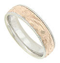 Figural rope edges fashioned of white gold flank an elaborate engraved design on the red gold center band of this 14K bi-color mens wedding ring
