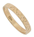 A pattern of jewel cut leaves presses together to form abstract flowers on the surface of this 14K red gold wedding band