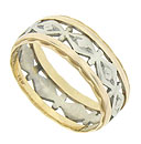 This 14K bi-color vintage wedding band features an  engraved ribbon of white gold abstract floral cutwork