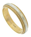 This handsome 14K bi-color features layers of abstract floral engraving, edged in strings of milgrain decoration