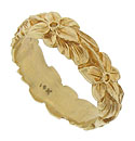 Deeply engraved full figured flowers and leaves wind across the surface of this 14K yellow gold wedding band