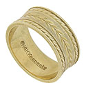 Layers of organic engraving and twisting gold adorn the face of this 14K yellow gold estate wedding band