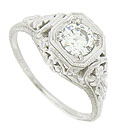 This phenomenal 14K white gold antique style engagement ring is set with a dazzling .54 carat, G color, Si1 clarity round cut diamond