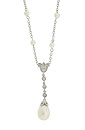 Pearls are set at intervals along the chain of this 14K white gold antique style necklace