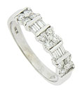 Dazzling round and baguette cut diamonds adorn the face of this 14K white gold wedding band