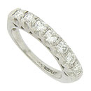 A string of seven sparkling diamonds stretches across the face of this vintage platinum wedding band