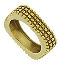This remarkable 18K yellow gold estate wedding band is adorned with a sprouting screen pattern