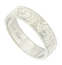 This handsome platinum wedding band is covered with an abstract organic engraving