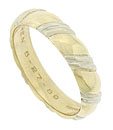 This classic band of 14K yellow gold is adorned with ribbons of white gold and polished to a bright sheen