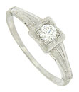 This elegant vintage platinum engagement ring is set with a dazzling .15 carat round cut diamond