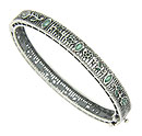 This elegant sterling silver bangle bracelet is decorated with horizontal filigree
