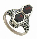 This sterling silver filigree ring has two bezel mounted garnets in a setting that gives it a look of the 1920's