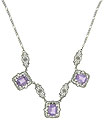 This lovely reproduction sterling silver necklace has 3 emerald cut amethyst stones mounted in sterling filigree settings
